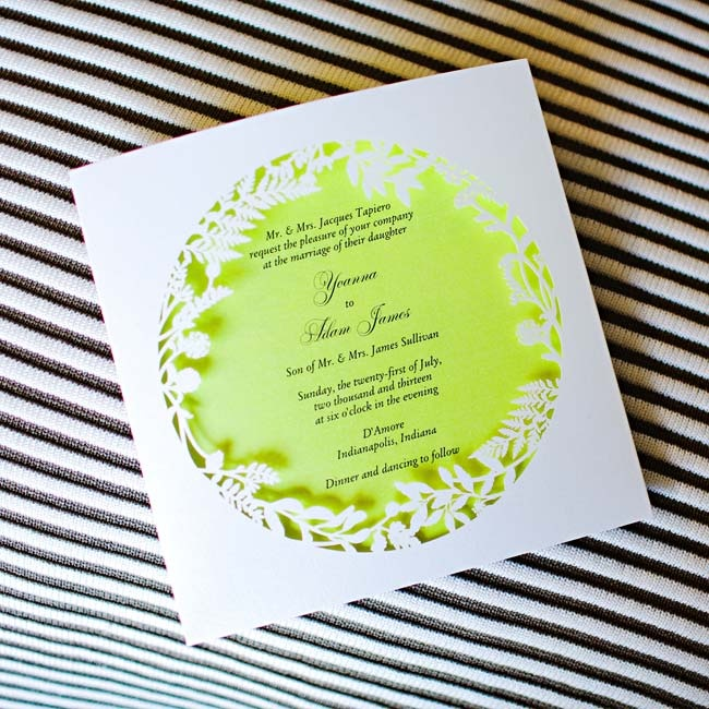 The couple's paper goods took a formal approach to the bright color palette with laser cut floral motifs and curled fonts.