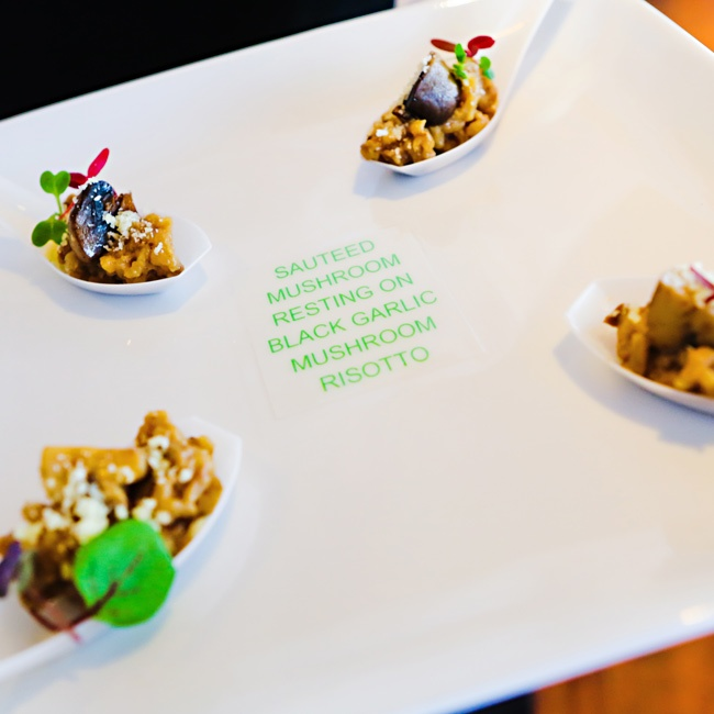 Appetizers were hand passed on white plates with green descriptions to guests knew what they were.