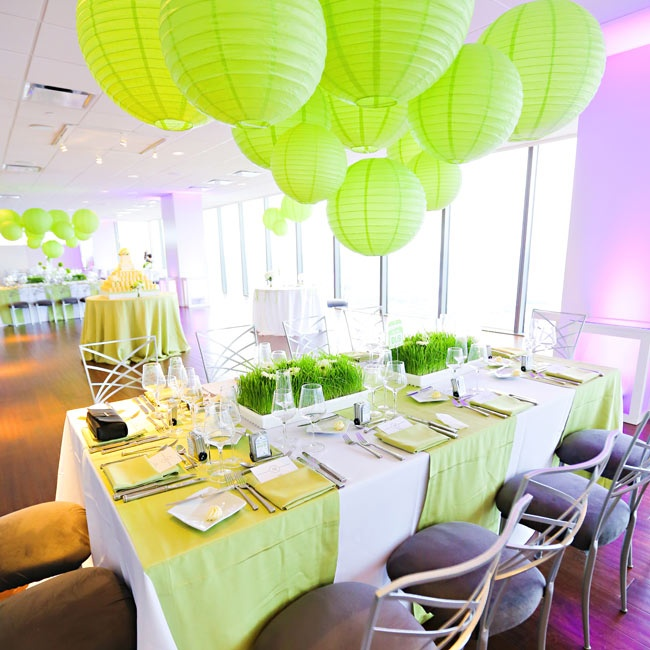 Paper lanterns in neon green made for a statement-making centerpiece at some of the reception tables.