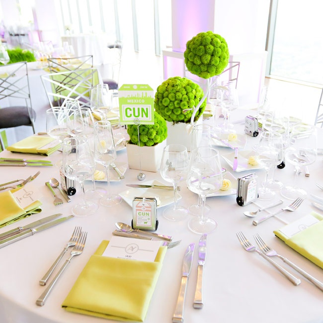 Three letter airport names made for fun table designations while green mum pomanders made unique centerpieces during the reception.