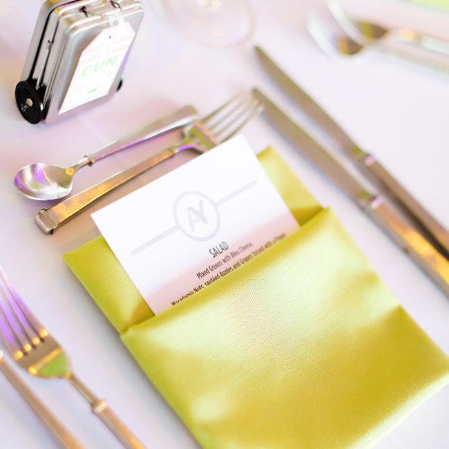 Even table settings were bright and cheery with lime green napkins and mini suitcases for favors.
