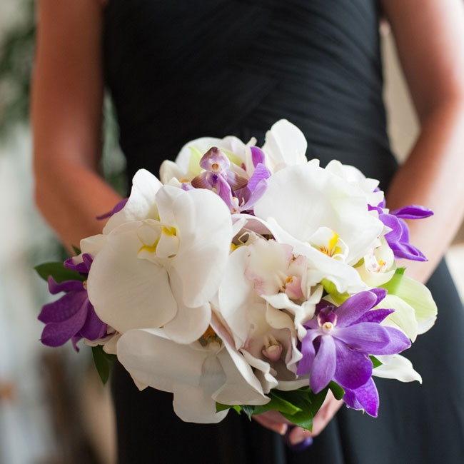 White and purple orchids made up the bridesmaid bouquets during the ceremony.