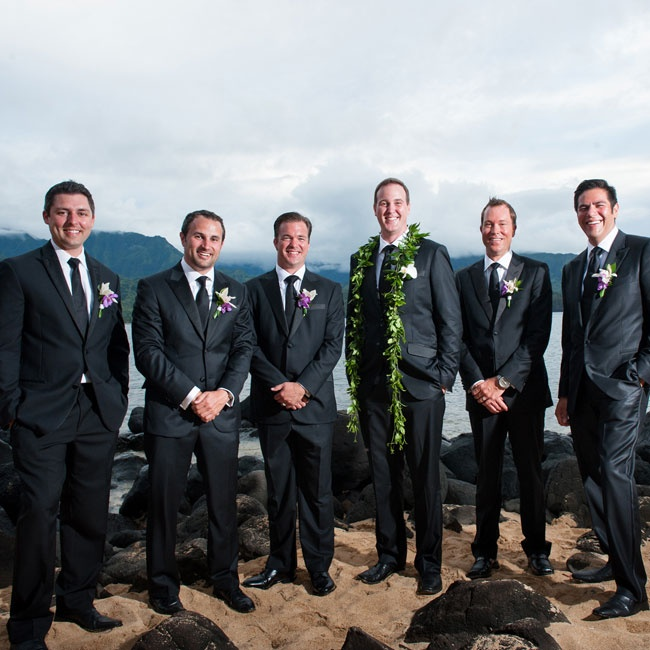 Guys wore dark, formal suits with matching ties for the ceremony while the groom distinguished himself with a leafy, green lei.