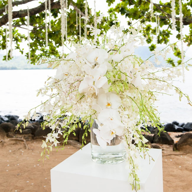 White orchids made for an eye-popping ceremony centerpiece during the outdoor festivities.