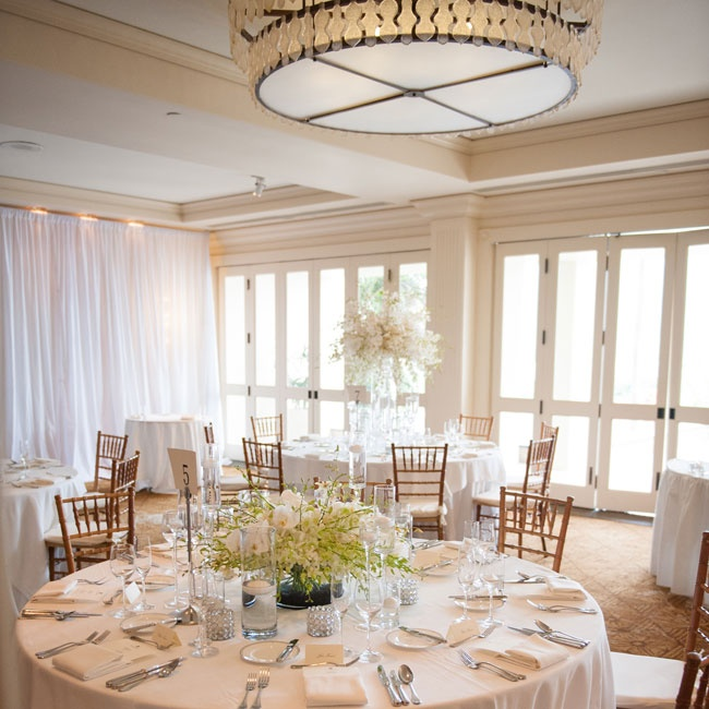 The elegant reception space was filled with golden Chiavari chairs and white linens and floral decor.
