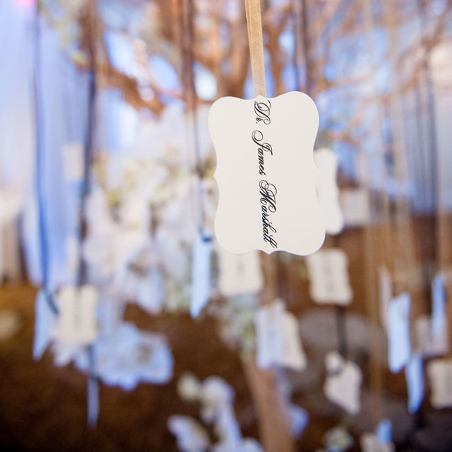 Guests found their formal, black and white escort cards hanging on metallic threads.