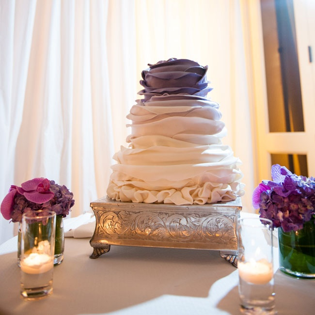 The couple's cake had a reverse-ombre affect, starting with deep purple on the top and fading to white near the bottom.