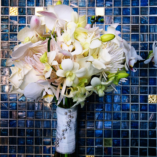 Anokhi's bouquet was full of tropical orchids, spider mums and roses.