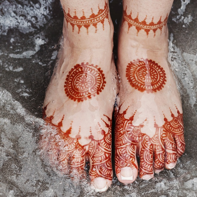 The bride's hands and feet were marked with traditional henna tattoo designs.