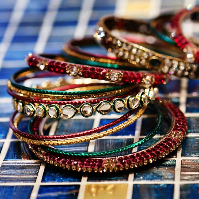 The bride stacked many colorful bangles on both wrists, following tradition.