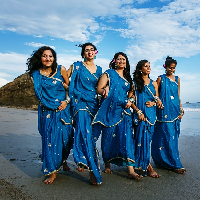 The bridal party wore matching royal blue and gold saris for the ceremony.