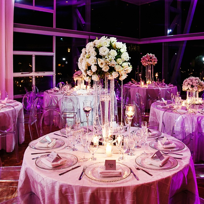 Whereas the ceremony was mostly red in decor, the reception used lighting effects to make the decor mostly purple.