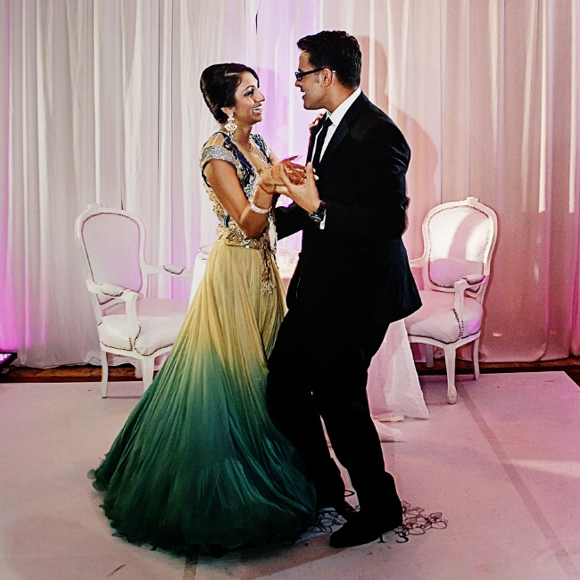The bride and groom changed attire for the reception into an A-line ombre green dress and a formal black suit.