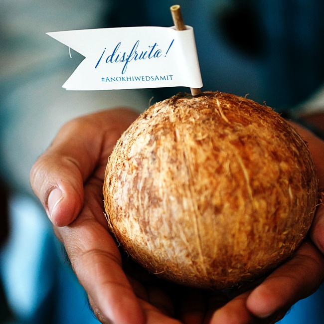 """Guests got coconuts with flags that said """"enjoy"""" from which they could drink and eat."""