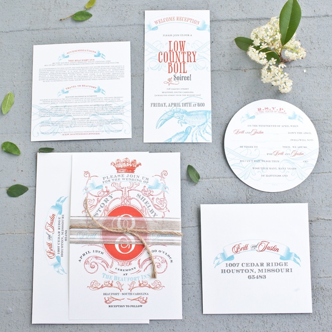 The red and blue invitation suite had a modern regal motif and used a mix of paper styles for a fun touch.