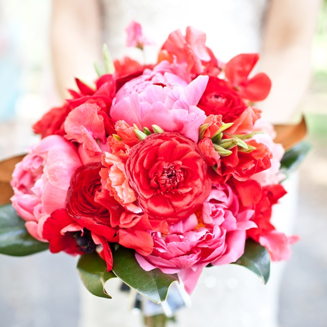 Britt's bouquet was filled with a mix of vibrant pink and red blooms, including peonies, zinnias, anemones and roses.