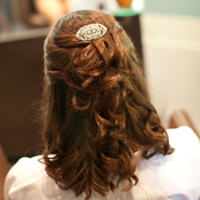 Britt wore her hair in a half updo with cascading curls and a crystal barrette.