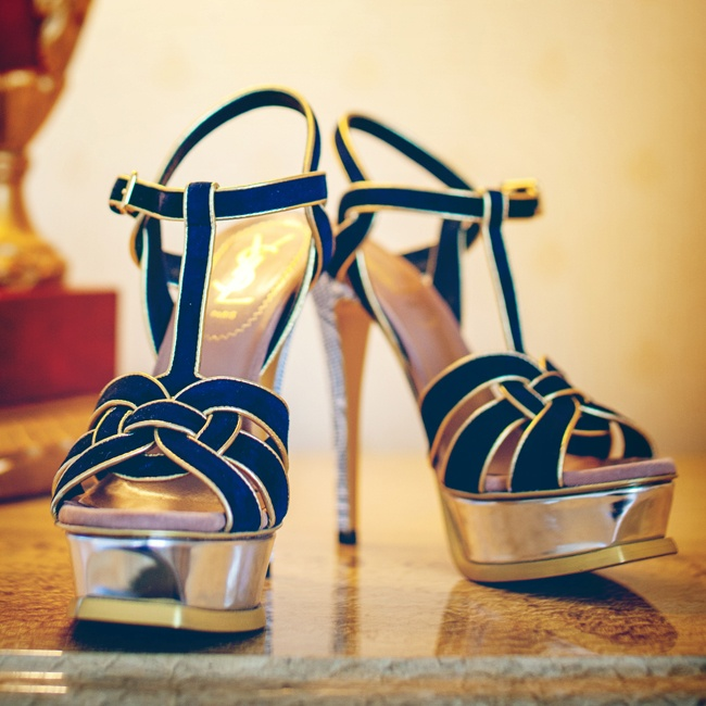 Tina walked down the aisle in pair of stylish navy YSL platform sandals with gold accents.