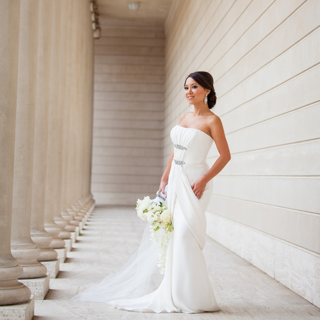 Tina wore an elegant Carolina Herrera trumpet-style gown. The satin dress had a sweetheart neckline, draped fabric that flowed from the bodice into a tulip shaped overlay and was accented by crystal embellishments.
