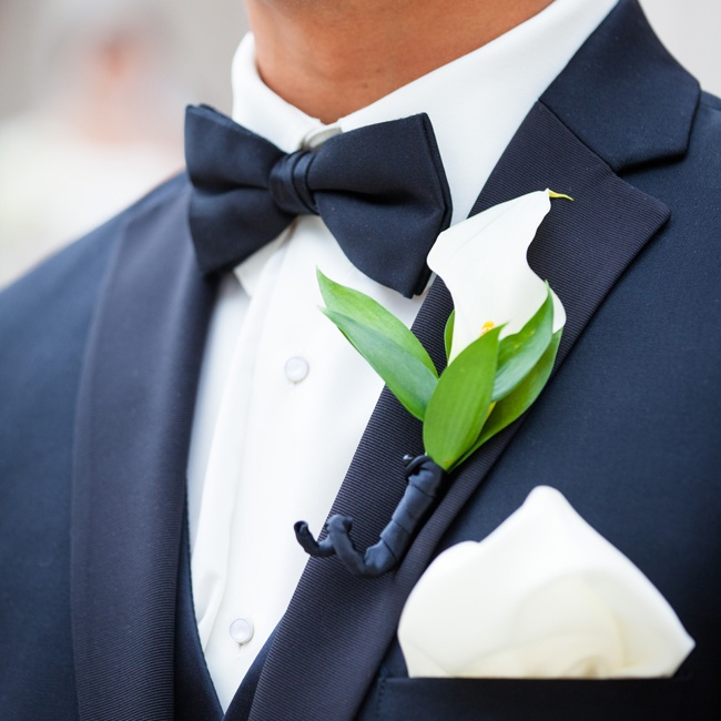 Johnnie wore a single white calla lily on his lapel to complement the look of his formal tuxedo.