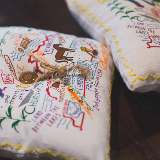 The ringbearers presented the rings on illustrated Kentucky-themed ring pillows with bright vibrant colors.