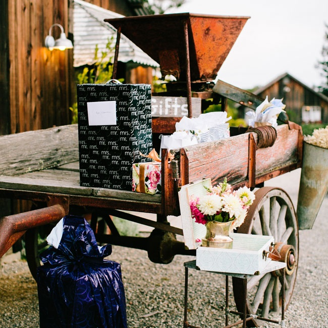A rustic antique wagon was used as a gift table.