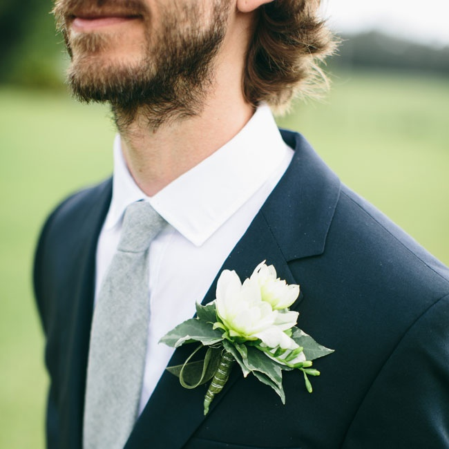 Ed paired his heathered, gray tie and dark suit with a simple white and green boutonniere.