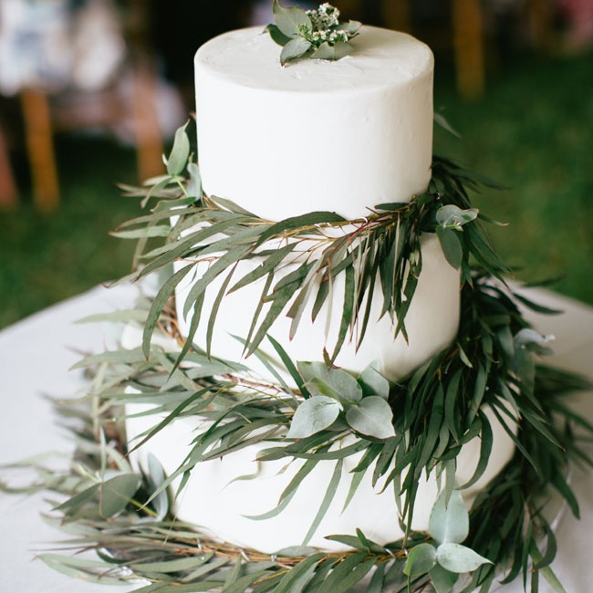 The couple's cake was a traditional white, round confection that was decorated with tropical garlands of eucalyptus.
