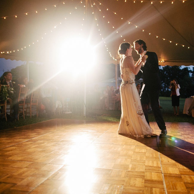 The couple's first dance as newlyweds took place on a wooden dance floor beneath their reception tent.