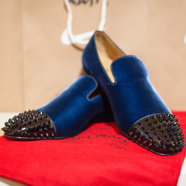 Johnnie put a modern twist on his look with a pair of navy blue Christian Louboutin loafers with studded black toes.