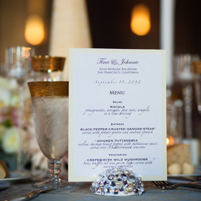 Simple ivory and white menu cards with formal script font were displayed in rhinestone and pearl-studded holders made by the bride.
