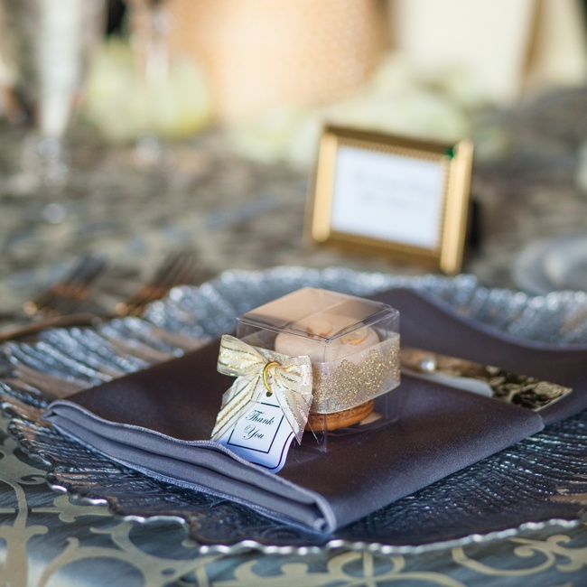 Boxes of macarons with ivory and gold organdy ribbon were placed at each place setting.