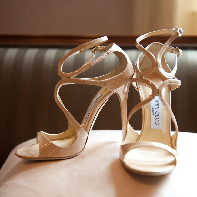 Brianna walked down the aisle in a stylish pair of strappy Jimmy Choo sandals in a neutral shade.