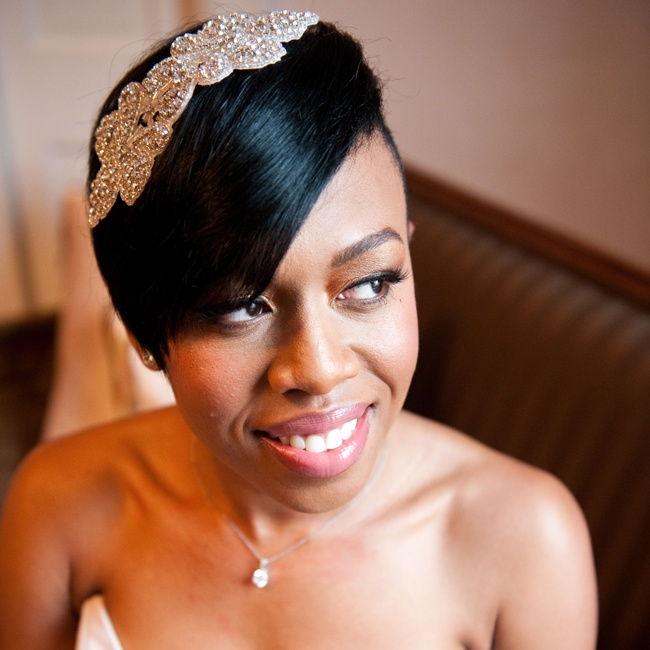 Brianna accessorized her sleek side swept hair style with a crystal and bead embellished hairpiece.