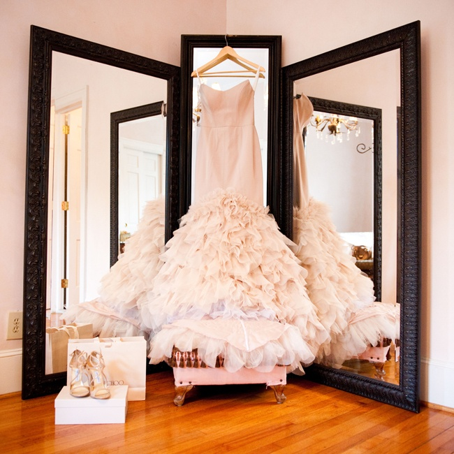 Brianna's blush fit and flair gown flowed into a cascade of layered tulle ruffles that gave the dress a romantic feel with a hint of glam.