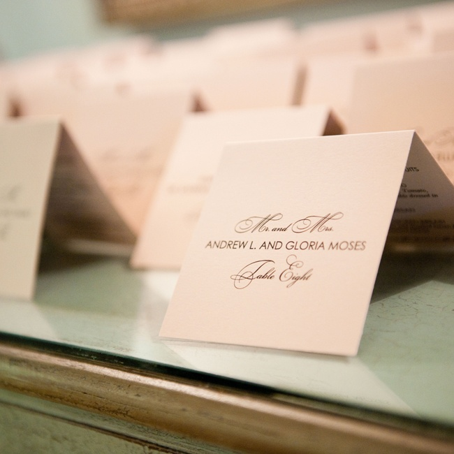 The couple chose simple escort cards with formal script typeface and ecru colored card stock paper.