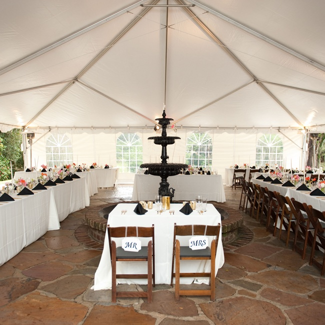 The reception took place at the fountain patio at the Legare-Waring House under a grand white tent. A black fountain stood in the center of the tent, giving the reception an elegant, garden party feel.