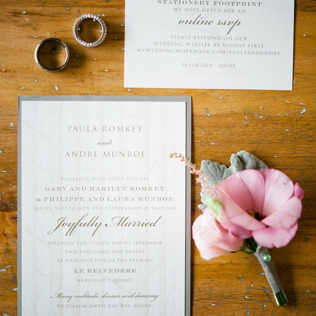 Paula and Andre's invitations had a traditional, formal look with a faint forest print for a subtle modern touch .