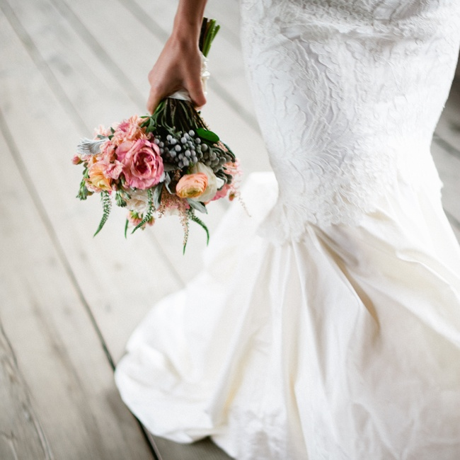 Paula's gown was and elegant silk trumpet gown with a lace overlay, pleated skirt and sweetheart neckline.
