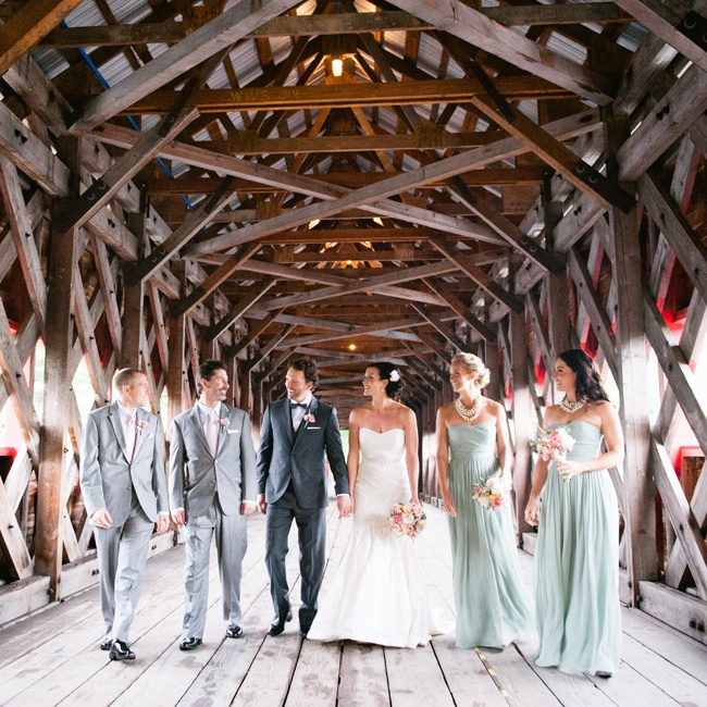 The wedding party was decked out in soft grays, pinks and sage green for an elegant sophisticated look. The guys accessorized their look with pale pink ties, while the girls wore layered strings of pearls that gave their long chiffon dresses a more formal feel.