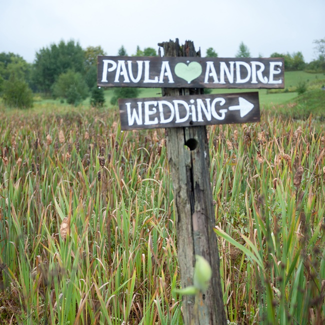 Hand-painted wooden signs guided guests to the wedding festivities.