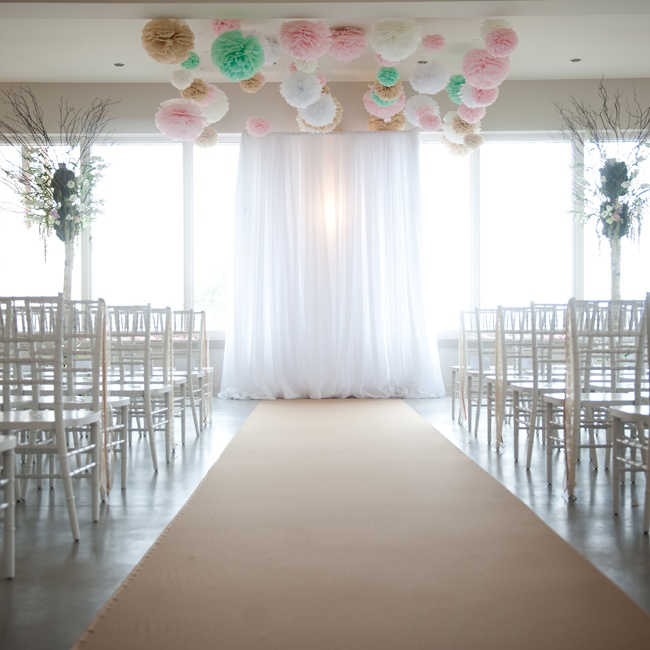 Birch trees with floral accents and flowing sheer fabric gave the ceremony an ethereal feel. Paper flowers in bright pink, mint green and white brought added a modern touch.