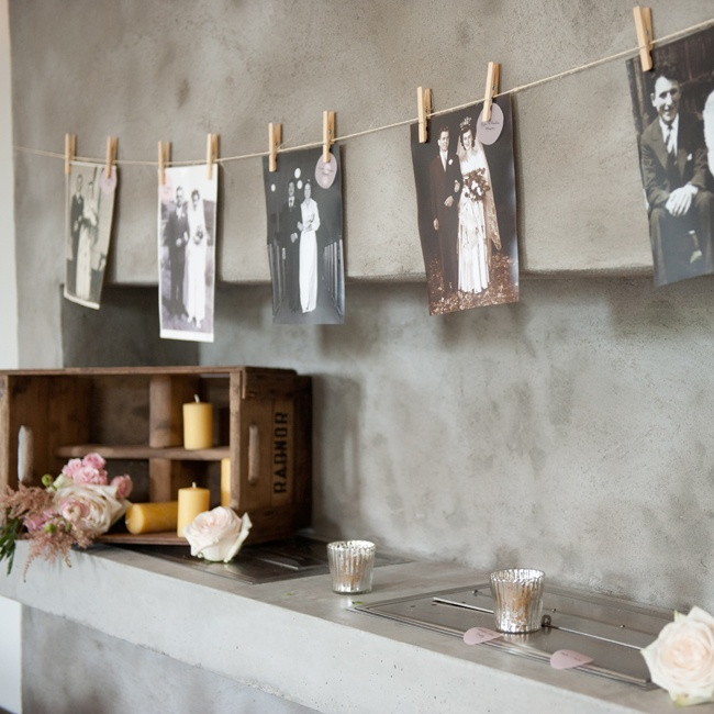 Vintage family wedding photos were hung strings of twine and secured with clothespins.