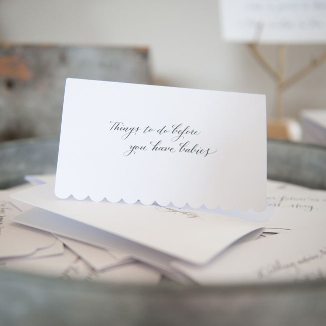 "Guests offered the newlyweds marriage advice by filling out advice cards, each with a different topic, like ""Things to do before you have babies."" The advice cards doubled as the couple's guestbook. In addition to filling out the advice cards, guests took a picture of themselves and put both the pictures and cards together in an envelope for the co ..."