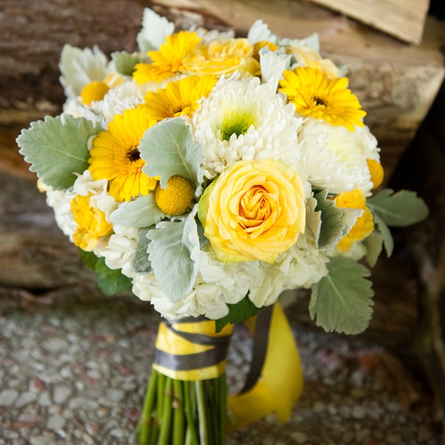 Gina's bouquet was a cheerful mix of yellow roses, billy balls and gerbera daisies that popped against lamb's ear and white mums.
