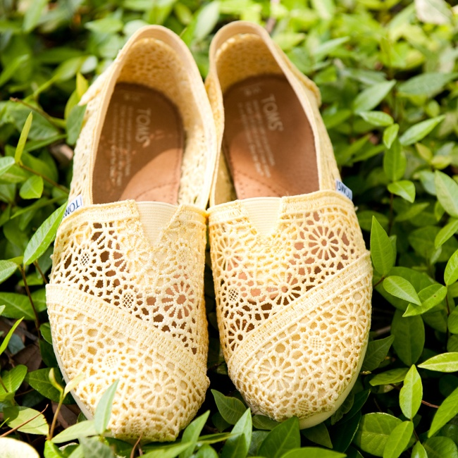 Gina went for comfort with a cute pair of pastel yellow Tom's in an eyelet fabric.