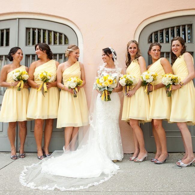The bridesmaids wore short one-shoulder chiffon dresses in a buttery yellow hue.