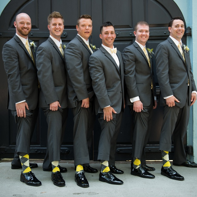 The groomsmen wore grey suits with yellow satin vests and matching ties. For a fun touch, they wore yellow and gray argyle socks.