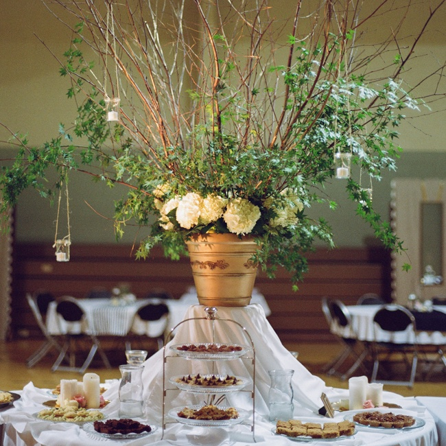Various desserts were placed beneath an impressive centerpiece of tree branches, vines and hydrangeas.