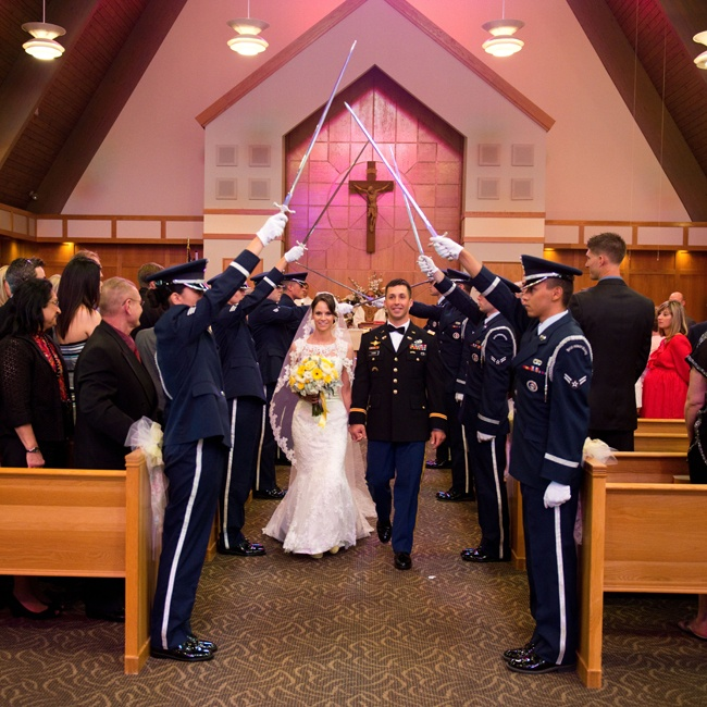 Gina and Shawn exchanged vows in a traditional church ceremony. Shawn wore his service uniform for the ceremony and the honor guard was present for the tradition of honoring the bride, where the bride and groom pass through an arch formed by swords.